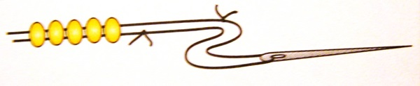 узелок на нити при плетении бисером